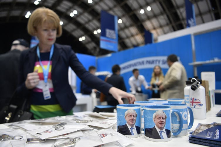 A delegate eyes up merchandise at the Conservative Party Conference. EPA